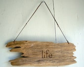 life. earth. driftwood sign