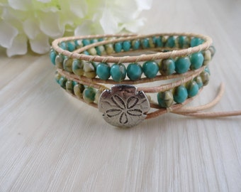 Double wrap  leather beaded bracelet with Turquoise and cream Czech  beads and a sand dollar