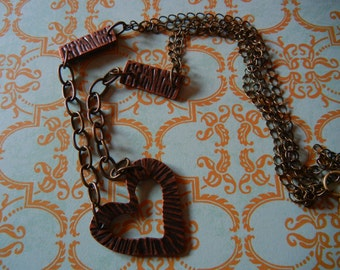 Industrial inspired chain with heart pendant