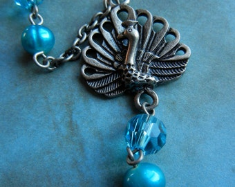 Silver Peacock and turquoise bead chain connector