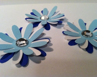 6 triple layered flower embellishments  (shades of blues and white)