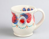 Porcelain Coffee Mug with Blue and Red Decorative Accents