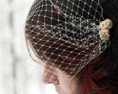 Bridal ivory hair fascinator birdcage veil