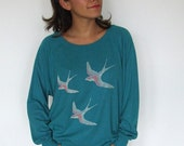 3 Bird, evergreen batwing sweat, silver and coral cross stitch embroidery