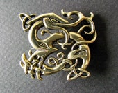 Urnes dragon brooch