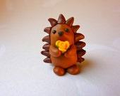 Hedgehog with Flower - Handmade FIMO polymer clay figure