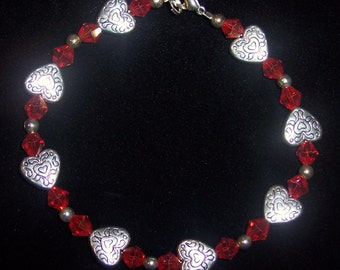 9 inch Beaded Bracelet with Ornate Hearts and Red-Orange Glass Czech Crystals