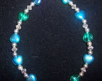 8 inch Beaded Bracelet with Iridescent Green-Blue Hearts