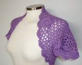 Lacy bolero shrug with flower brooch