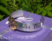 Name- childs-childrens-kiddies-cuff bangle oval shape with riveted copper flower -customizable-MADE TO ORDER-by Angie Beadz