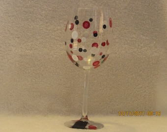 Wine glass with red, white, black dots hand painted
