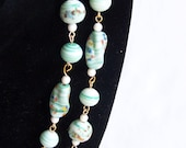 Vintage necklace with painted porcelain beads.