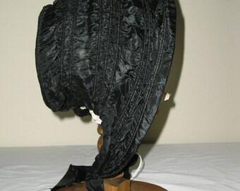 1850s Black silk taffeta gathered bonnet
