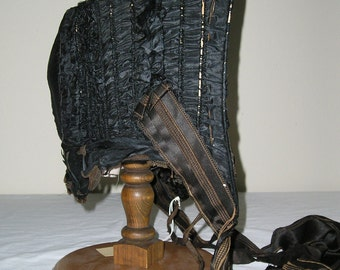 1860s Black silk taffeta gathered bonnet