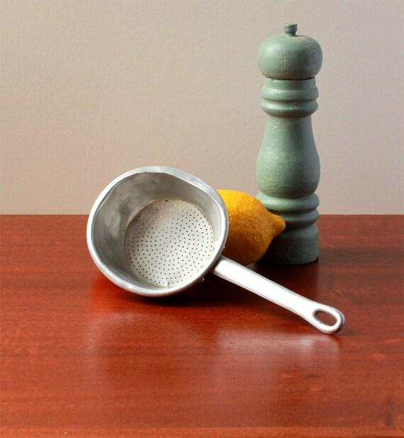 Vintage aluminum sieve with handle