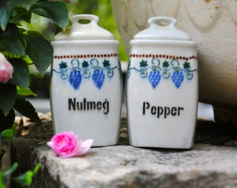 Sale on Darling Little German Canisters for Nutmeg and Pepper with grapevine border!