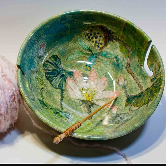 Yarn bowl for two balls of yarn with dragonflys and lotus flowers on it.