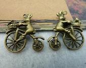 10pcs 21x22mm Antique Bronze Lovely Bear riding a bicycle / bike Charms Pendant. c2450-2