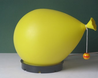 Yellow table or wall balloon lamp designed by Yves Christin