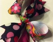Flower and polka dot swirl hair bow