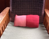 Upcycled ecofriendly sweater pillow in pink and red colorblock