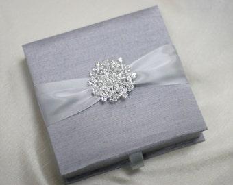 Wedding Invitation Silk Fabric Box with Satin Ribbon and a Shimmery Rhinestone Brooch