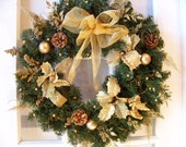 "22"" Gold wreath with little cherub and gift boxes"