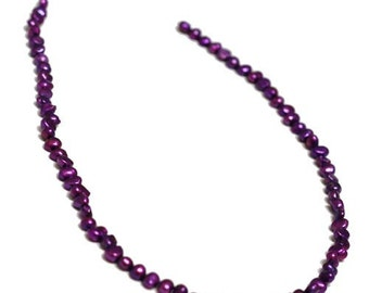 Pearl, cultured freshwater (dyed), dark-purple, 4-5 mm Baroque Pearl. Sold per 14.5-inch strand.