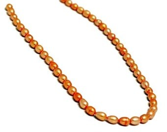 Pearl, cultured freshwater (Dyed), Yellow, 6-7mm Rice Pearl. Sold per 14.5 inch strand.