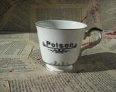 Poison teacup vintage