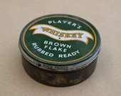 Vintage hand rolling tobacco tin