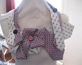 Pink, white and blue flowers feature in both ties used for this one of a kind upcycled necktie creation.
