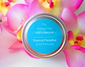 Solid perfume tin with tropical paradise fragrance.