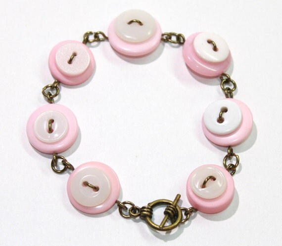 Button bracelet in pastel pink and white, antique brass wire wrapped button jewelry
