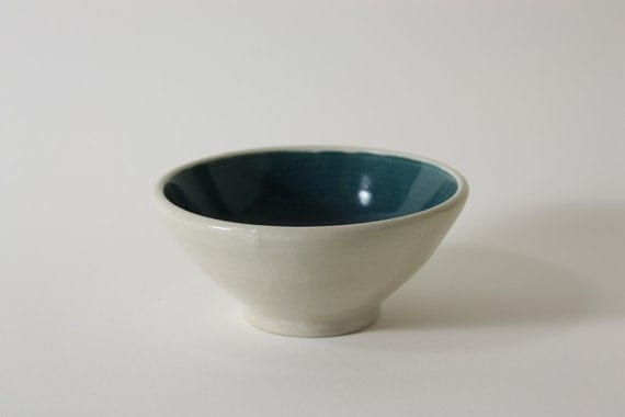 small hand thrown porcelain bowl with deep turquoise and clear crackle glazes