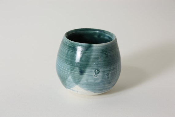 roly-poly bud vase handthrown with blue glaze