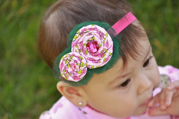 Enchanted Garden baby headband - pink and green satin rosettes with rhinestones and green tulle backing on a hot pink band