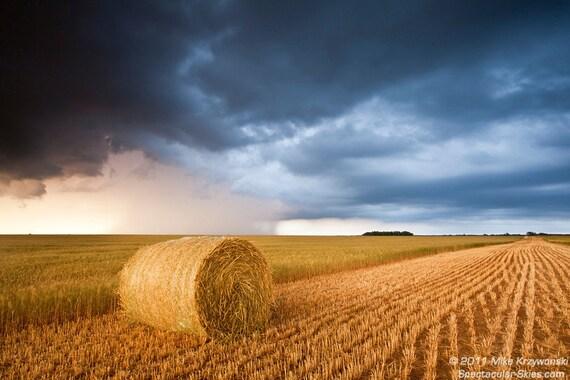 Hay Bale Under Storm Clouds in Kansas