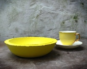 Bright yellow plaster, stone finish bowl