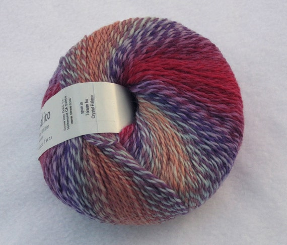 Crystal Palace Sausalito 8120 Borealis. purple, brown, deep red. aqua, self striping lace merino wool blend yarn
