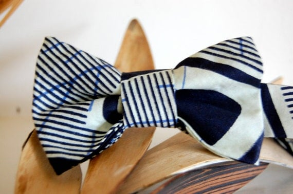African Fabric Bow Tie, with bold blue and white stripes. Great wedding accessory and gift for men or women. Real shell buttons on back