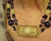 Handmade necklace, one of a kind, amethyst, gold plate beads and gold tone jewelry design with vintage focal but style for today.