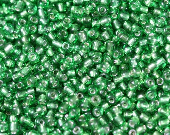 Green transparent silver lined size 11/0 glass seed beads - 15 grams