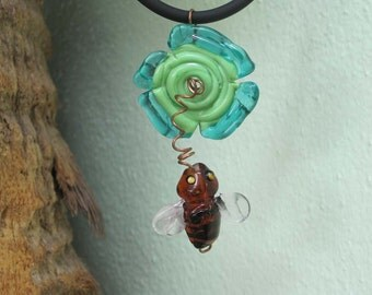 Lampwork Glass Bee To Flower Pendant Necklace on Black Rubber