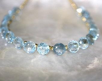 Blue topaz and 14k gold princess necklace