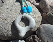 Open Circle Rock Necklace. Mediterranean Beach Stone on soft mint Faux Suede cord OOAK