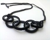 Beaded necklace. Black circles.