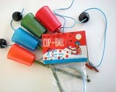Four cup and ball game party favors