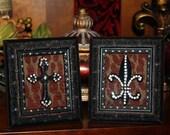 A Paid of Swarovski Crystal Embellished Frames with Black Cross and Fleur De Lis