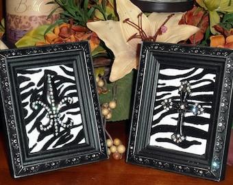 A pair of  Swarovski Crystal Embellished Frames with Cross and Fleur De Lis on Zebra Background